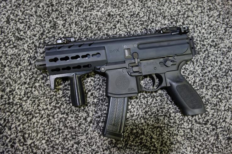 Name:  SIG_SAUER_SIG_MPX_Machine_Pistol_Submachine_Gun_SBR_Carbine_Multi-Caliber_PDW_Personal_Defense_W.jpg Views: 2617 Size:  101.2 KB